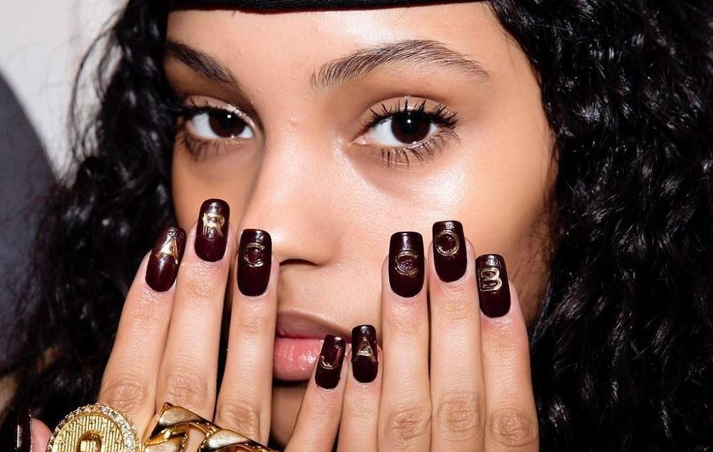 cozy vibe logo nails
